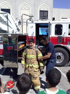 Haron gets to try on firefighter gear!