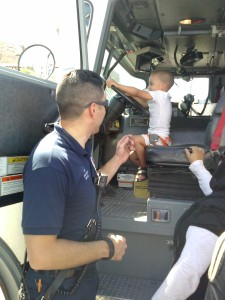 Aiden gets in the driver's seat of the fire truck. Exciting!
